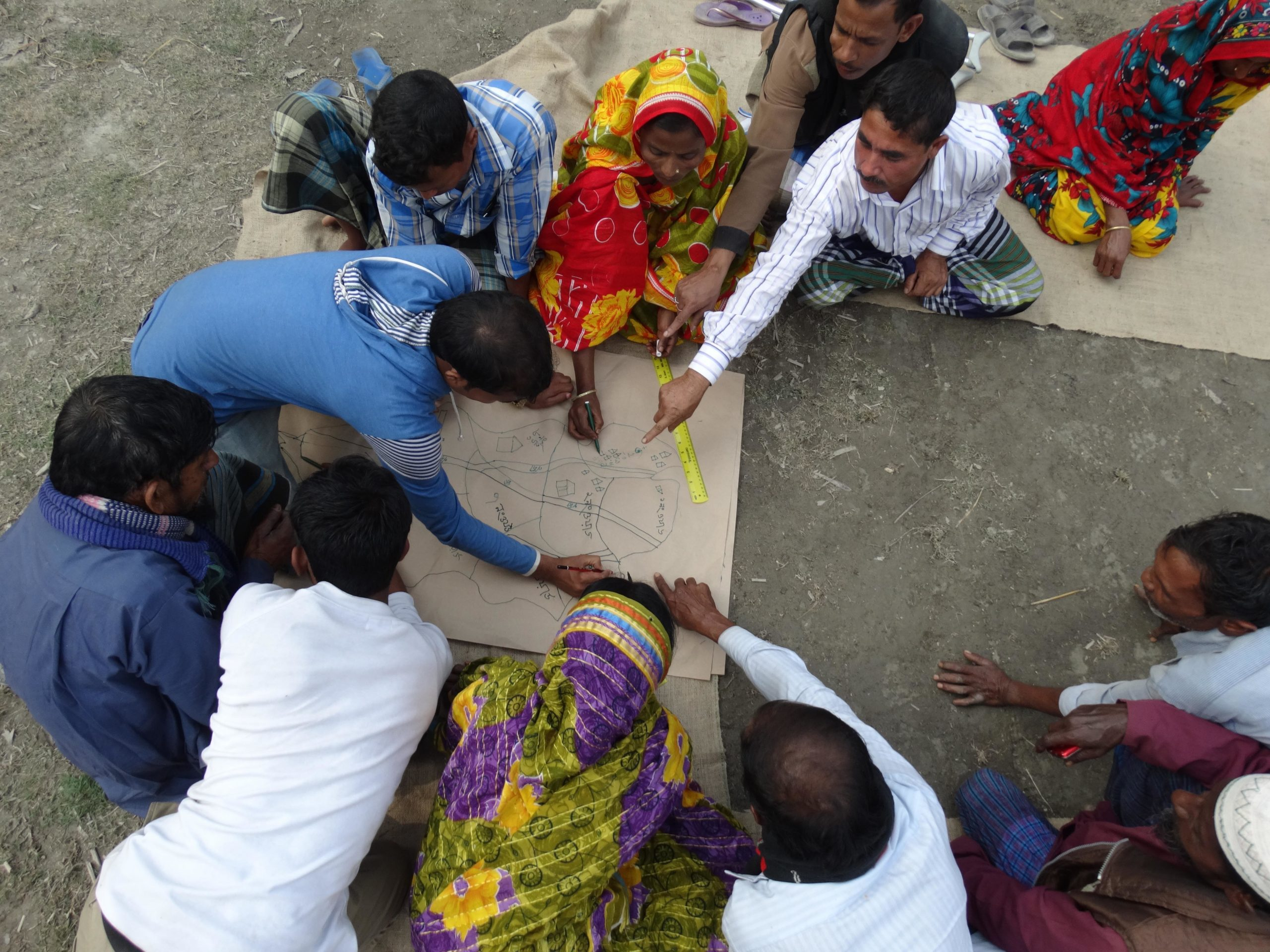 A group of people doing a disaster risk mapping in Bangladesh in 2014. Photo by CDD and CBM.
